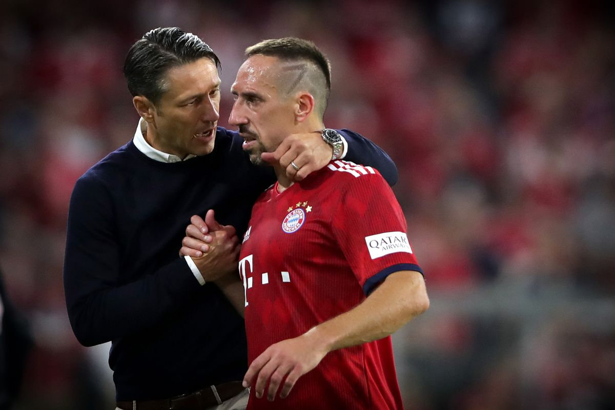 FC Bayern Muenchen v TSG 1899 Hoffenheim - Bundesliga MUNICH, GERMANY - AUGUST 24: EDITORS NOTE: DIGITAL FILTER USED TO CREATE THIS PICTURE: Niko Kovac, head coach of Muenchen talks to his player Franck Ribery during the Bundesliga match between FC Bayern Muenchen and TSG 1899 Hoffenheim at Allianz Arena on August 24, 2018 in Munich, Germany.