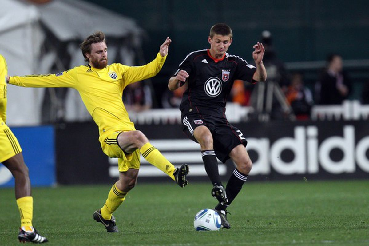 WASHINGTON, D.C. - MARCH 19: Perry Kitchen #23 of D.C. United controls the ball against Eddie Gaven #12 of the Columbus Crew at RFK Stadium on March 19, 2011 in Washington, DC. (Photo by Ned Dishman/Getty Images)