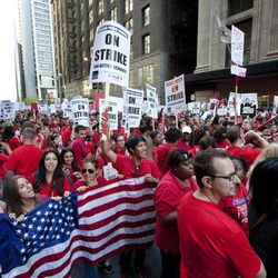 Thousands of public school teachers rally outside the Chicago Public Schools district headquarters on the first day of strike action over teachers' contracts on Monday, Sept. 10, 2012 in Chicago. For the first time in a quarter century, Chicago teachers walked out of the classroom Monday, taking a bitter contract dispute over evaluations and job security to the streets of the nation's third-largest city — and to a national audience — less than a week after most schools opened for fall.