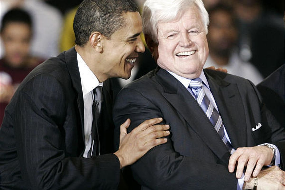 Then Democratic presidential hopeful Sen. Barack Obama, D-Ill., laughs with Sen. Ted Kennedy, D-Mass., during a rally for Obama at American University on Jan. 28, 2008, in Washington, D.C.