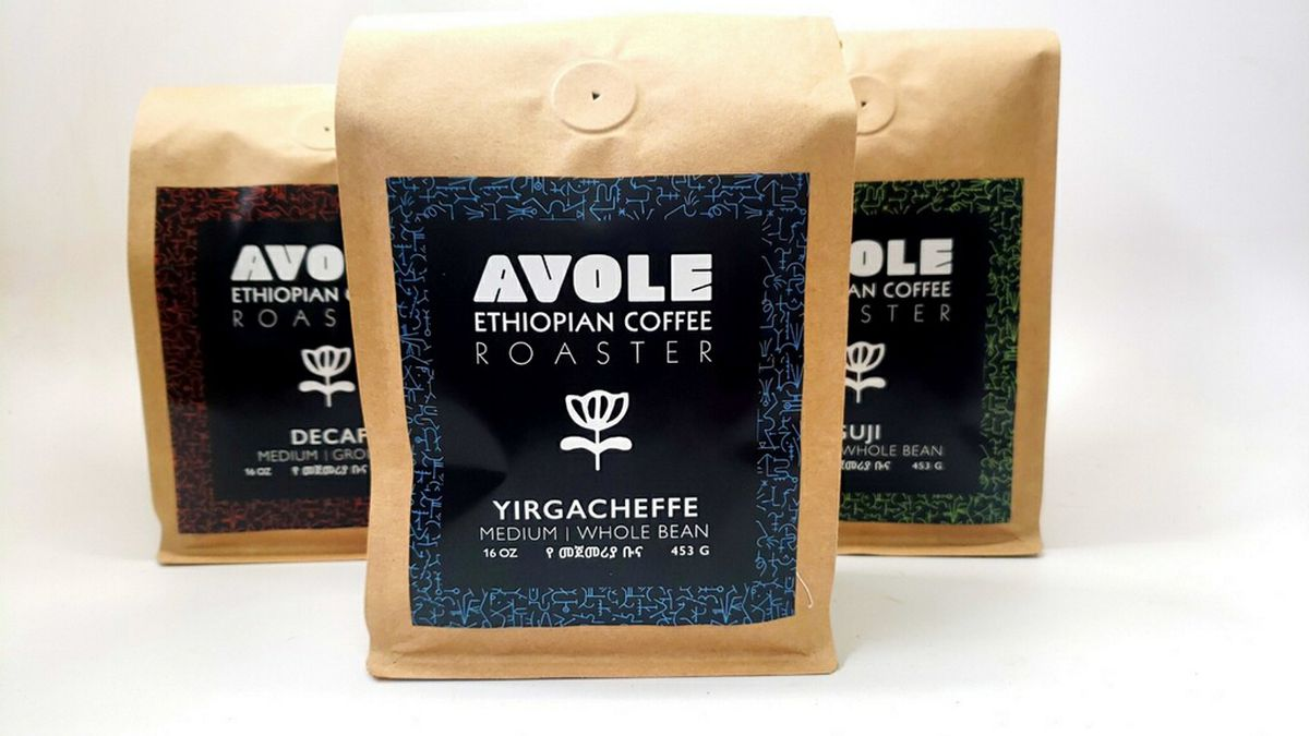 Three bags of Avole coffee beans against a bright white background