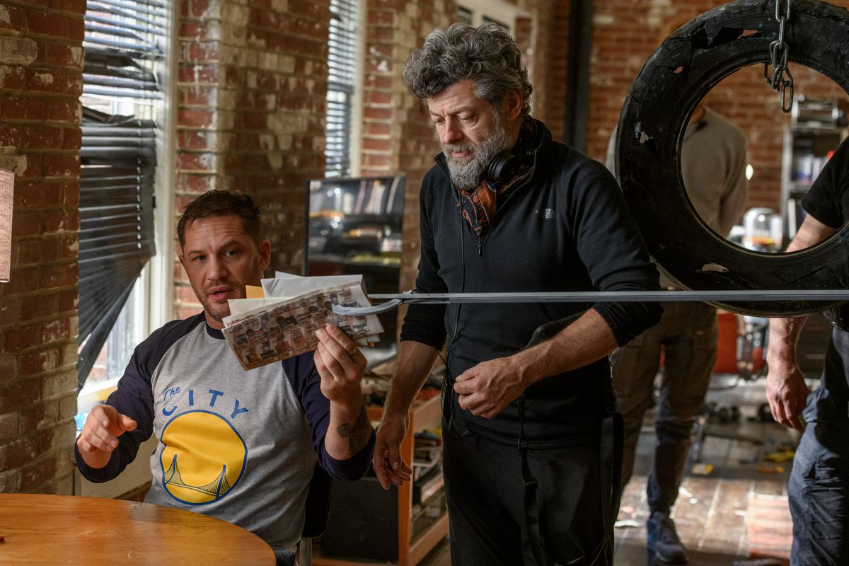 Tom Hardy and Andy Serkis at a kitchen table on set of Venome: Let There Be Carnage