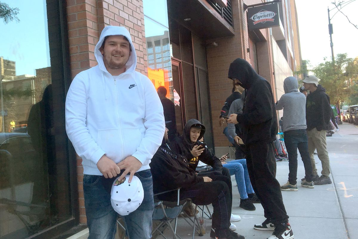 Mike Joy, 23, of Plainfield, waiting in line outside S V R N clothing store in the West Loop Friday morning.