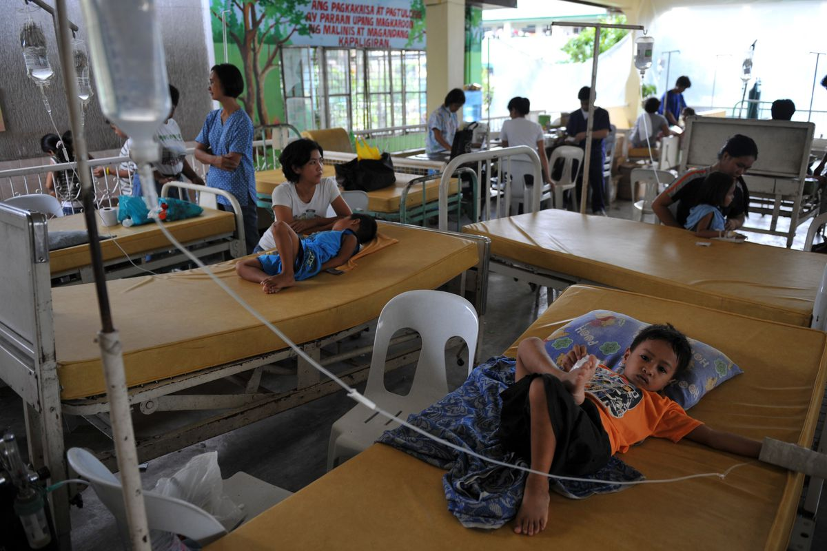Children receive treatment in the town of San Pedro, in Laguna province, south of Manila, Philippines on October 4, 2009, one week after tropical storm Ketsana poured the heaviest rains in four decades on the region.
