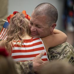U.S. Army reservist Staff Sgt. Dan Gustavson, of the 312th Medical Logistics Company out of Seagoville, Texas, hugs daughter Aria during a surprise homecoming at Vision Dance and Learning in South Jordan on Monday, May 3, 2021. Gustavson has been serving in Iraq for nine months.