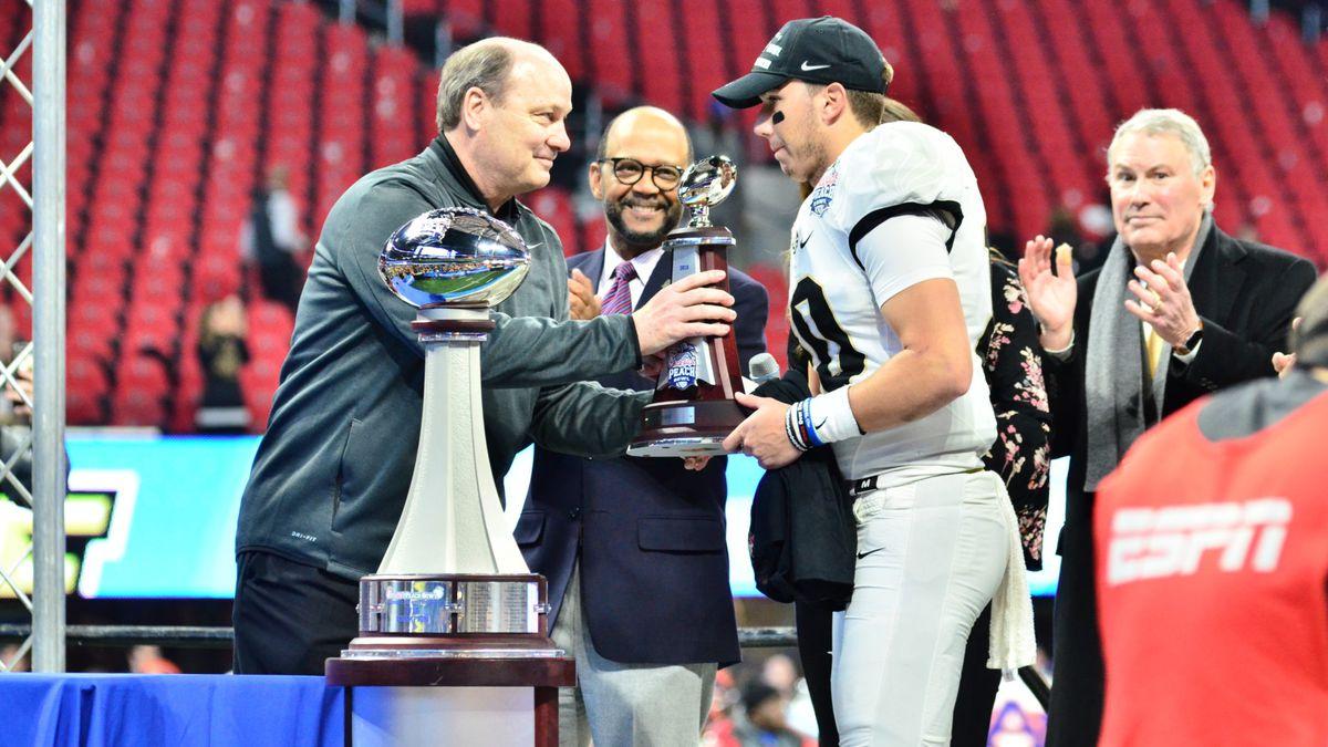 UCF QB McKenzie Milton accepts the award for Peach Bowl Offensive MVP. (Photo: Derek Warden)