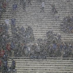 Flash and rain require delay during the second half of the University of Utah-BYU football game at LaVell Edwards Stadium in Provo on Thursday, August 29, 2019.