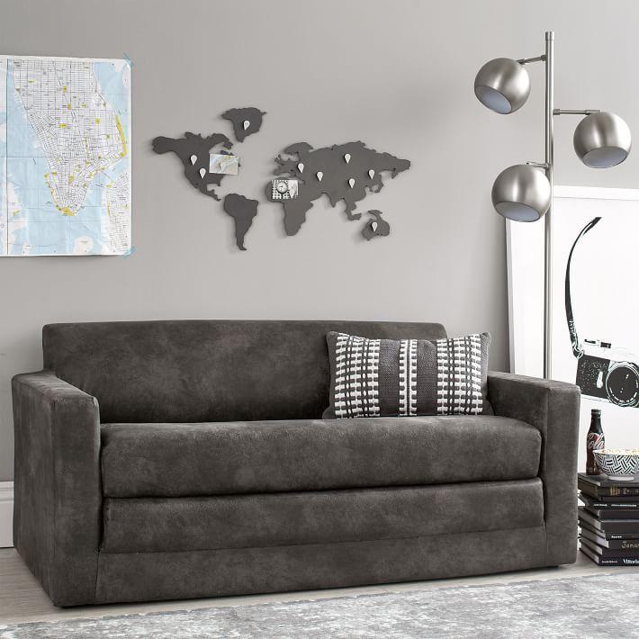 Dark gray sofa with squared edges.