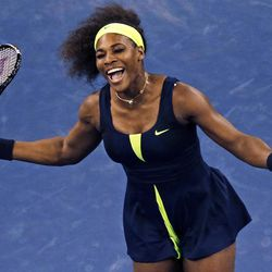 Serena Williams reacts at the net after missing a return against Ana Ivanovic, of Serbia, during the quarterfinal round of play at the U.S. Open tennis tournament, Wednesday, Sept. 5, 2012, in New York. (AP Photo/Charles Krupa)