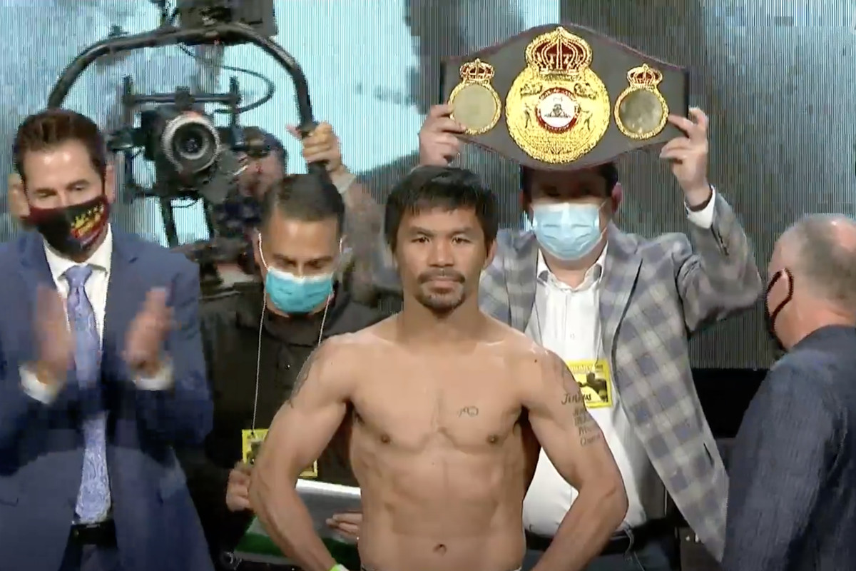 Manny Pacquiao weighing in for Saturday's bout against Yordenis Ugas.