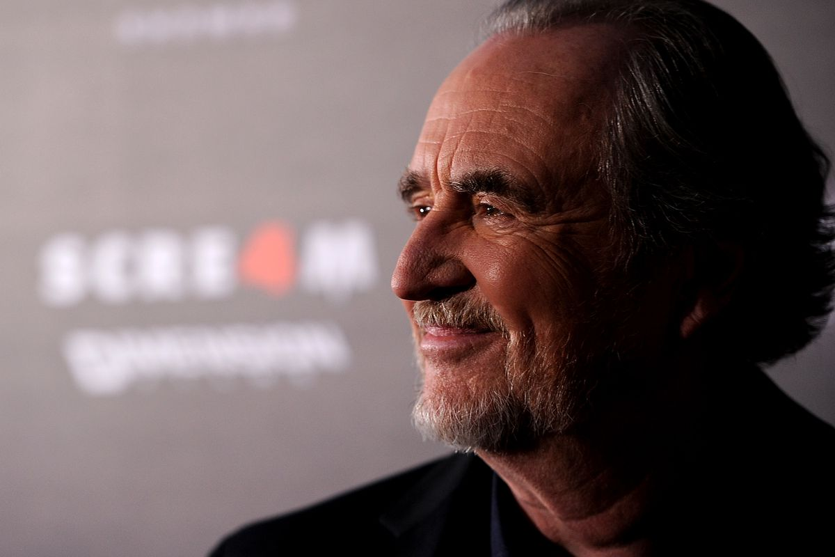 Director Wes Craven arrives at the premiere of Scream 4, the last film he directed.