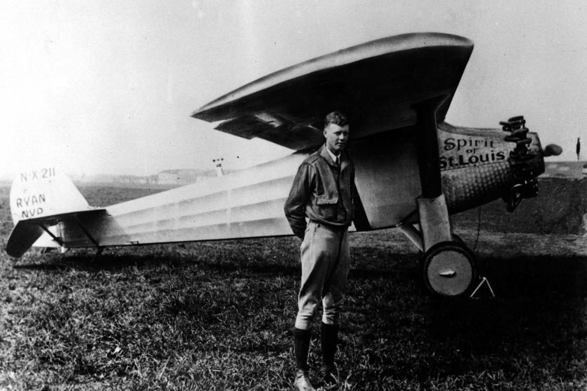 Charles A. Lindbergh is shown in this 1927 file photo with his plane, the Spirit of St. Louis, with which he made the first solo crossing of the atlantic from west to east, the same year.