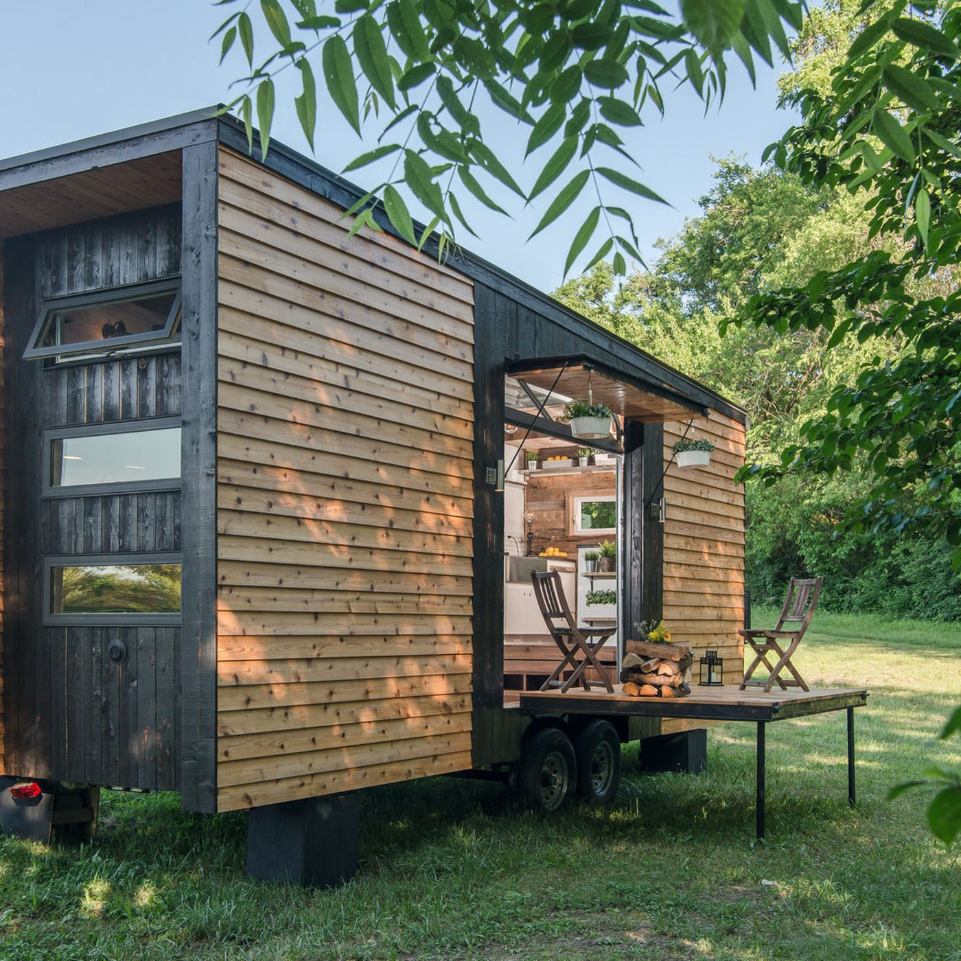 Tricked Out Tiny Home Features Garage Door and Custom Deck - Curbed