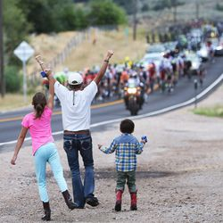 Sue Bishop and her grandchildren Kirsten and Kyden Bishop cheer on the riders as they pass by near Woodland during stage seven of the Larry H. Miller Tour of Utah, starting and finishing in Park City on Sunday, Aug. 7, 2016.