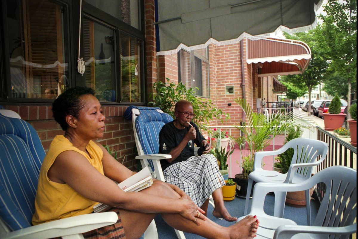 Mattie Cloves, 80, (right) claims to be first black person to move onto the 6200 block of Osage Ave. in Philadelaphia, sits on her porch with her daughter Nan Chaniey on June 24 1996. Eleven years after officials dropped a bomb on the MOVE house and let t