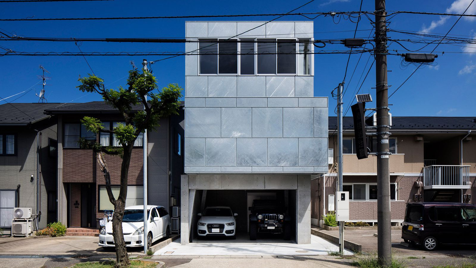 Steel Clad Home In Japan Is Made Of Three Stacked Volumes