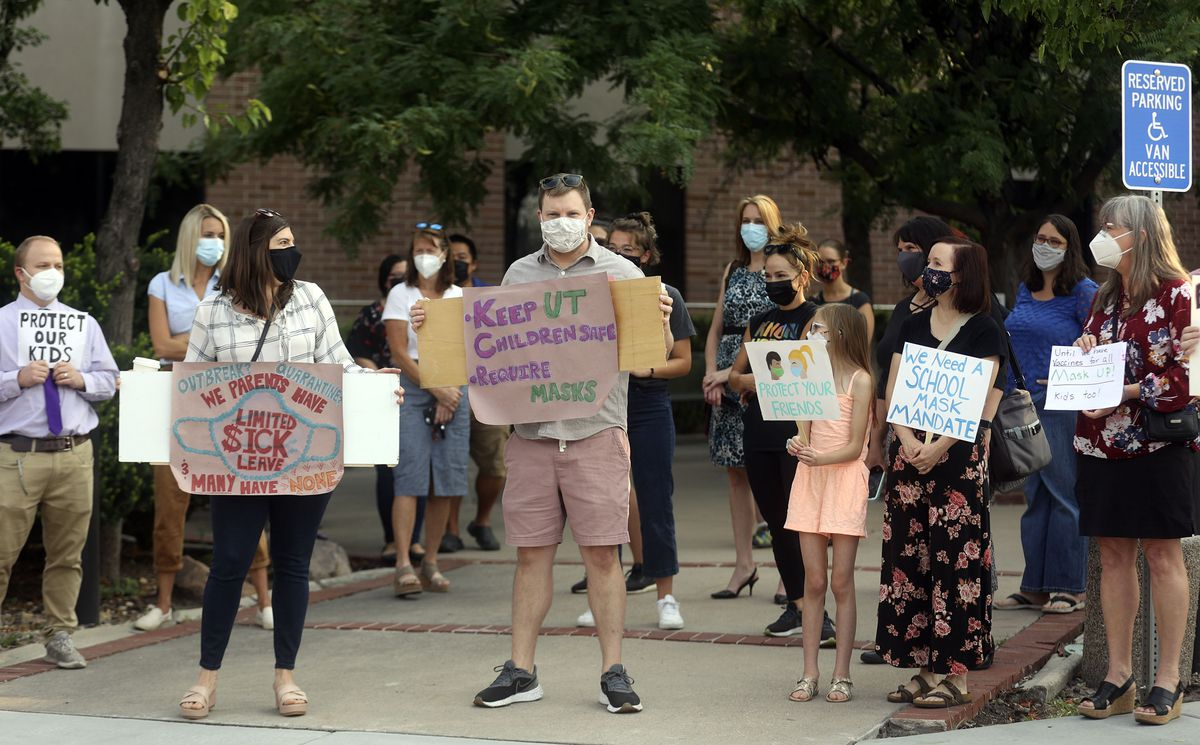 Parents, teachers and students rally in support of school mask mandates outside of the Utah State Board of Education office in Salt Lake City on Friday, Aug. 6, 2021.
