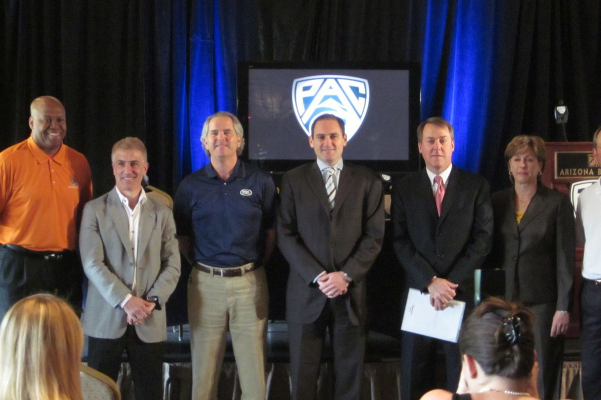 Larry Scott (center) with Fox Sports and ESPN executives at a press conference in Phoenix, AZ announcing a new media deal for the Pac-12. (Photo by Jose Romero, SB Nation Arizona)