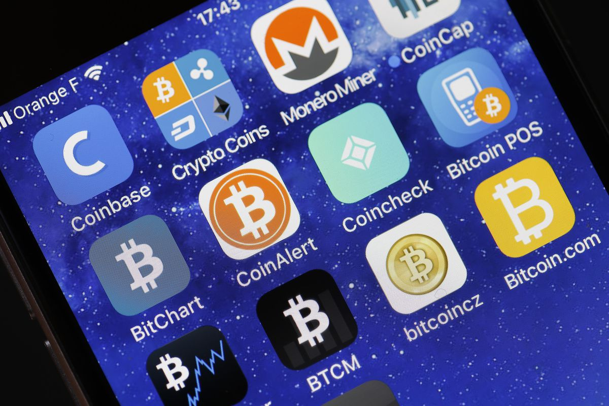 In this photo illustration, the icon of the Coincheck cryptocurrency exchange application is seen on the screen of an iPhone on February 16, 2018, in Paris, France.