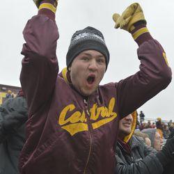 A CMU fan reacts to a Tyrone Scott score in the first quarter.