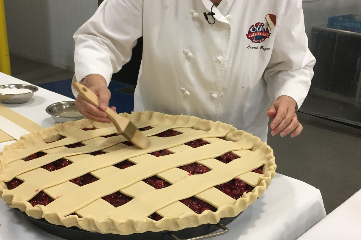 A clear, flavorless glaze is brushed across the top of the pie, which is then topped with a sprinkling of granulated sugar and baked.   Miriam Di Nunzio/Sun-Times