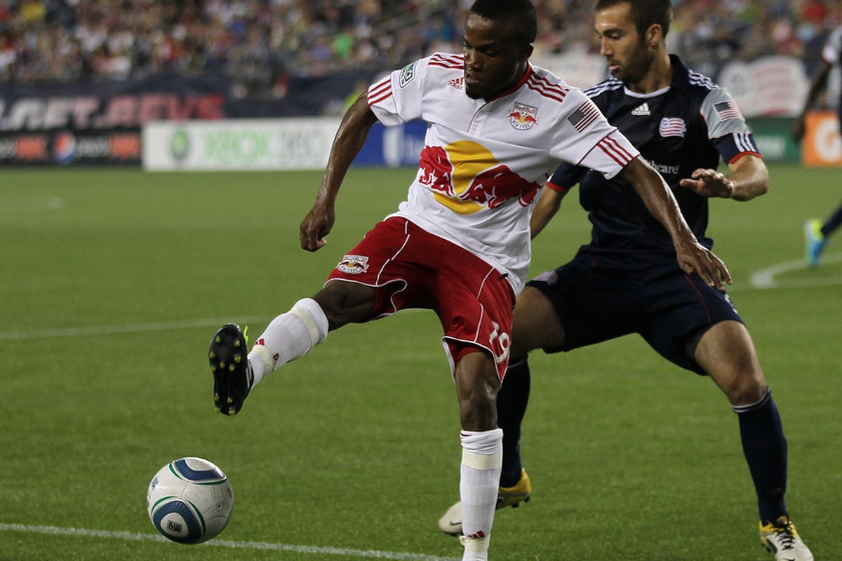 FOXBORO, MA - AUGUST 20: Ryan Cochrane #45 of the New England Revolution battles Dane Richards #19 of the New York Red Bulls at Gillette Stadium on August 20, 2011 in Foxboro, Massachusetts. (Photo by Jim Rogash/Getty Images)