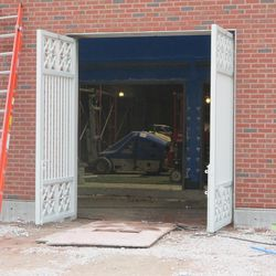 3:38 p.m. New gates installed at one of the side gates, along Sheffield -