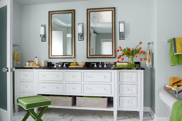 Double vanity with twin sinks and mirrors.
