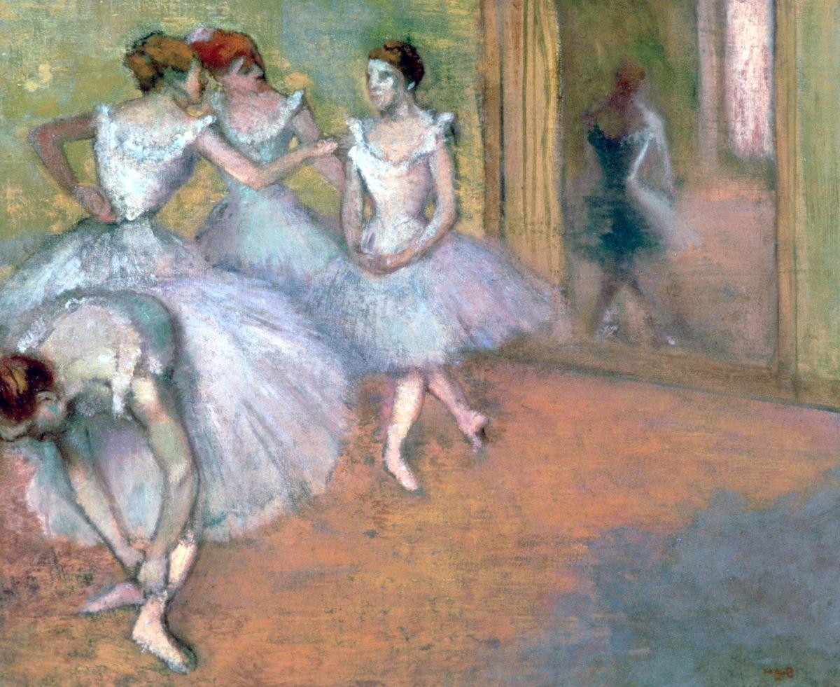 four ballerinas in white dresses prepare to dance