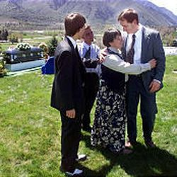 Andre Malan, right, comforts Loydene Berg after Peter Berg's funeral on May 2, 2000. Malan, who was a close friend of Peter, spoke at the services in Mountain Green, Morgan County.