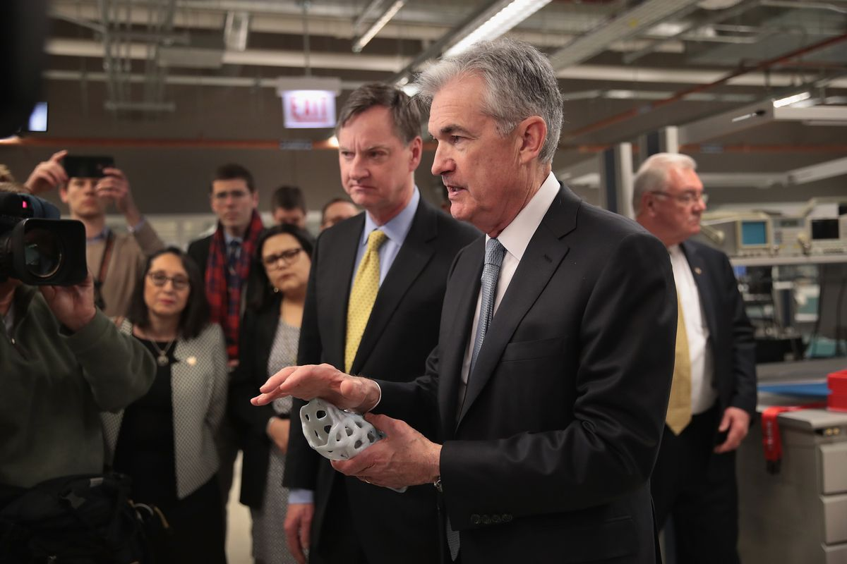 Federal Reserve Chairman Jerome Powell, foreground, and Charles Evans, president of the Federal Reserve Bank of Chicago, tour the mHUB center for advanced manufacturing in 2018.