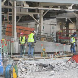 3:10 p.m. Getting ready to pour a new concrete floor at the main bleacher gate -