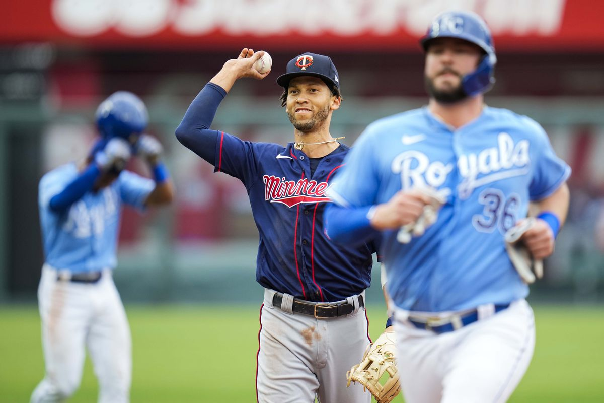 Minnesota Twins shortstop Andrelton Simmons (9) throws to first base to complete a triple play as Kansas City Royals catcher Cam Gallagher (36) and center fielder Jarrod Dyson (1) look on during the third inning at Kauffman Stadium. Mandatory Credit: Jay Biggerstaff