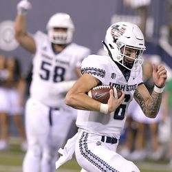 Utah State quarterback Andrew Peasley (6) runs down the field for a 59 yard touchdown during the second half of an NCAA college football game against North Dakota on Friday, Sept. 10, 2021, in Logan, Utah.