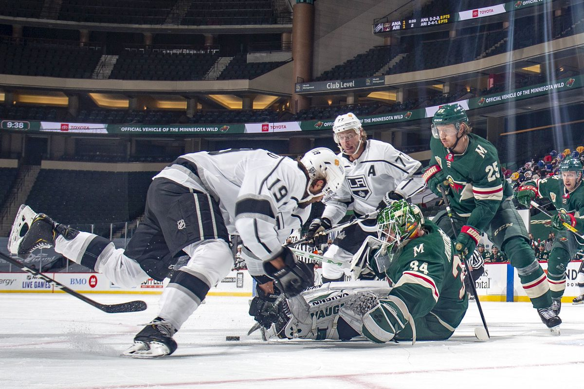 Kaapo Kahkonen #34 and Jonas Brodin #25 of the Minnesota Wild defend against Alex Iafallo #19 and Jeff Carter #77 of the Los Angeles Kings during the game at the Xcel Energy Center on January 28, 2021 in Saint Paul, Minnesota.