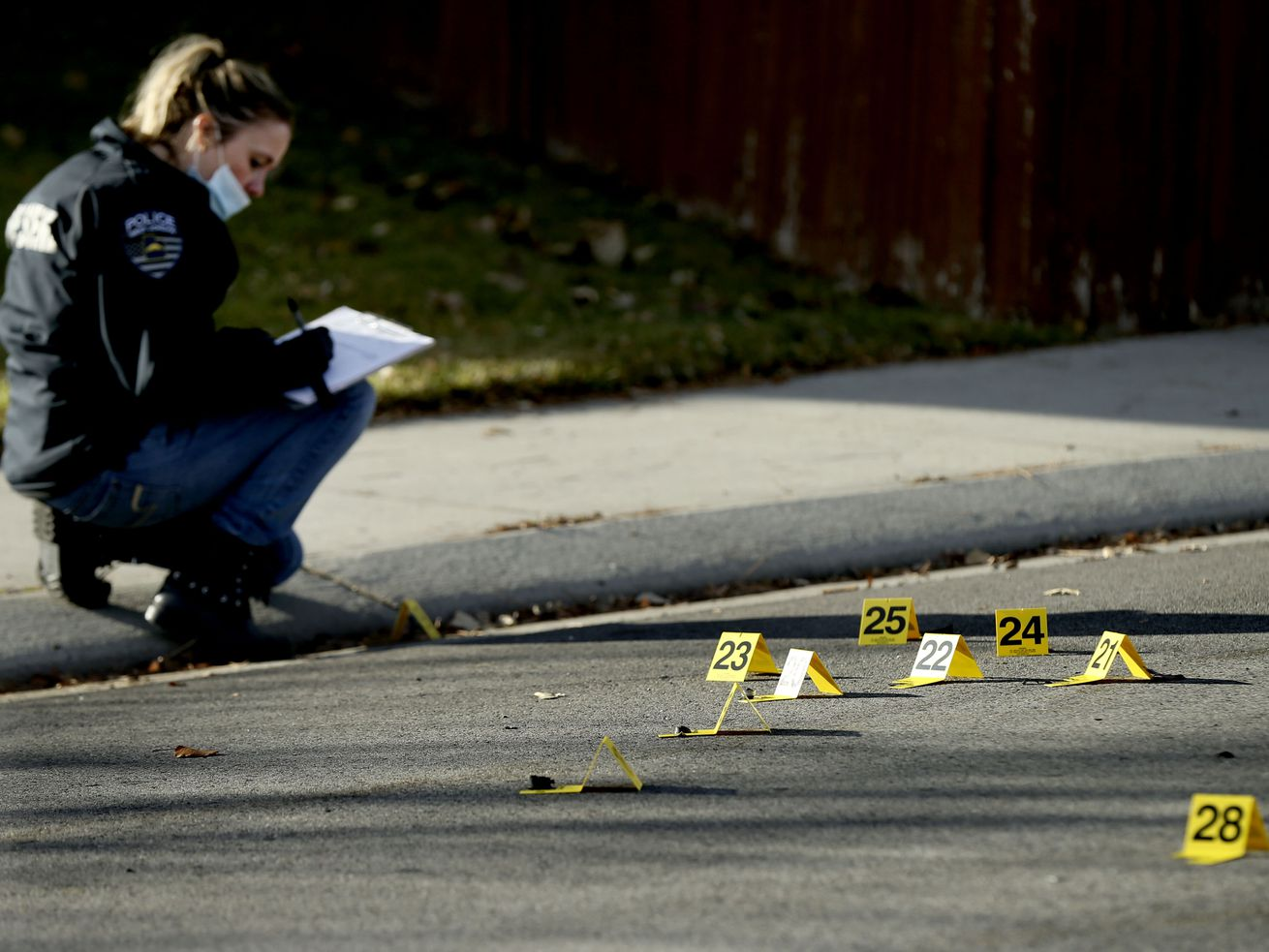 A West Jordan police officer investigates the scene of a shooting that left one man dead in West Jordan on Thursday, Nov. 19, 2020. Officers responded to the area of 7000 South and 5200 West about 2:30 a.m. and found a man deceased in the street.