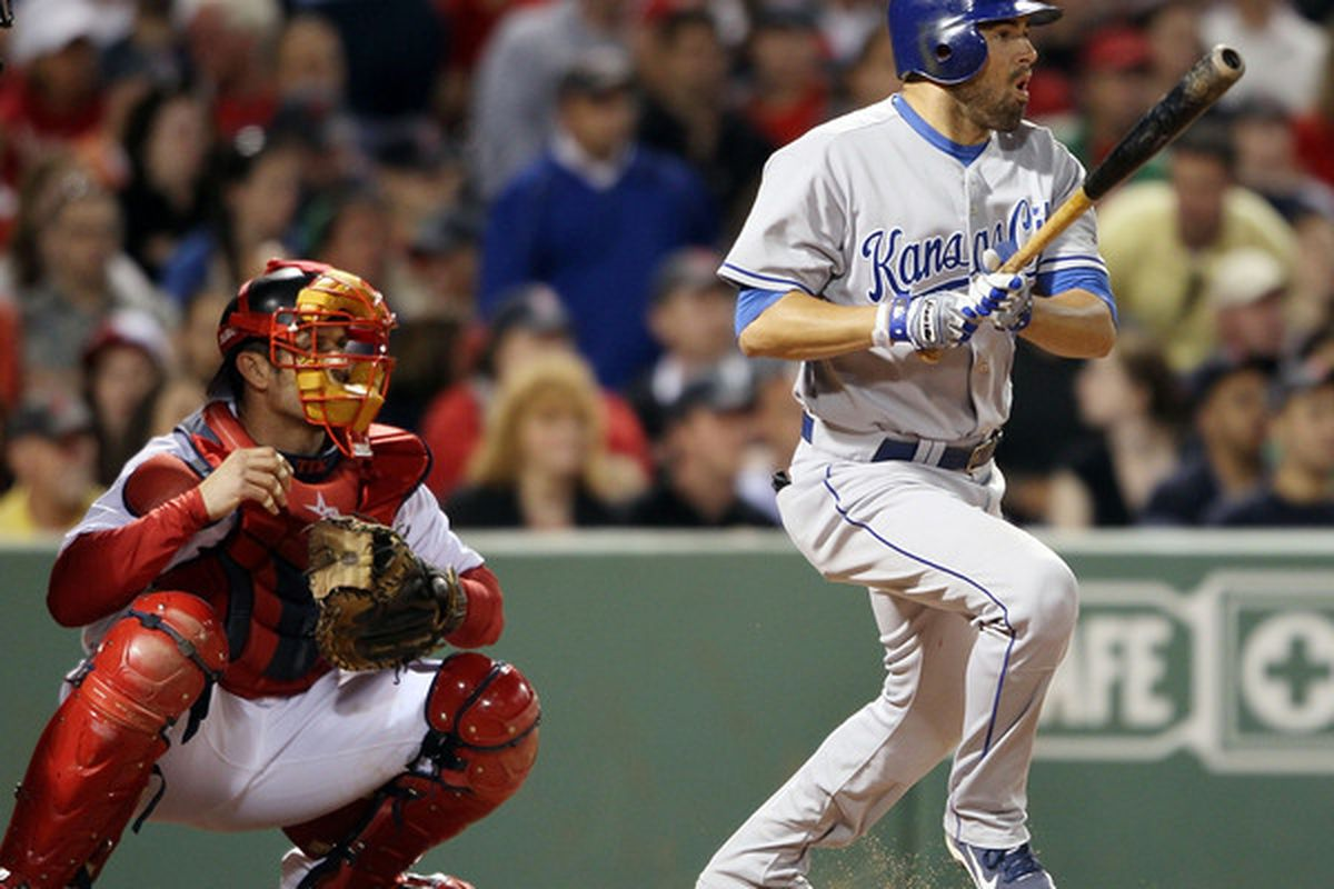 BOSTON - MAY 27:  David DeJesus #9 of the Kansas City Royals hits an RBI double in the sixth inning as Jason Varitek #33 of the Boston Red Sox catches on May 27, 2010 at Fenway Park in Boston, Massachusetts.  (Photo by Elsa/Getty Images)