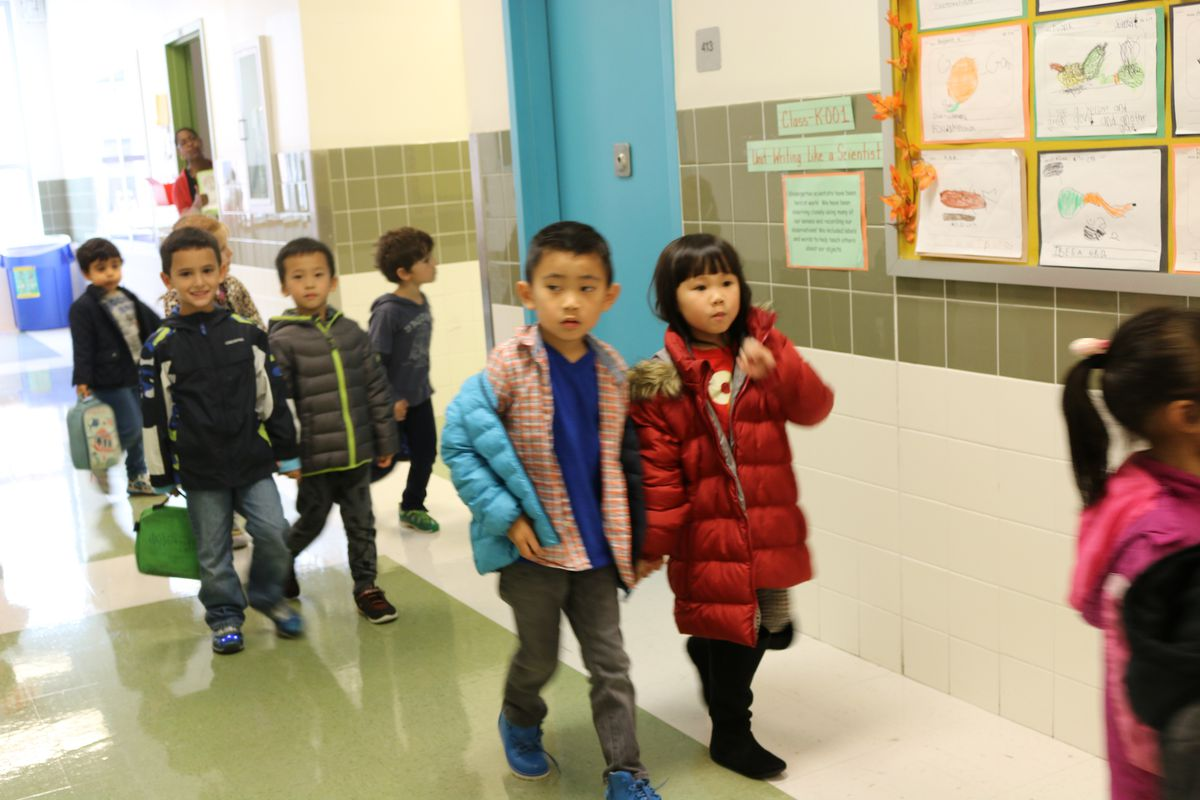 Kindergarten students at Brooklyn School of Inquiry, a gifted and talented program in New York City, walk to recess in 2016.