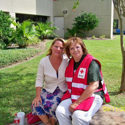 In this Sept. 11, 2012 photo provided by the American Red Cross, Brenda LaFlamme, left, waits outside Ochsner Medical Center-North Shore in Slidell, La., with Deborah Kemp, of Ann Arbor, Mich., a volunteer with the American Red Cross Safe and Well program. Kemp reunited LaFlamme with her father, Larry Bailey, who was treated at the hospital after being rescued from Hurricane Isaac's floods on Aug. 30, 2012. He had been brought to the emergency room several days after the rescue, incoherent and bleeding from an infected month-old wound.
