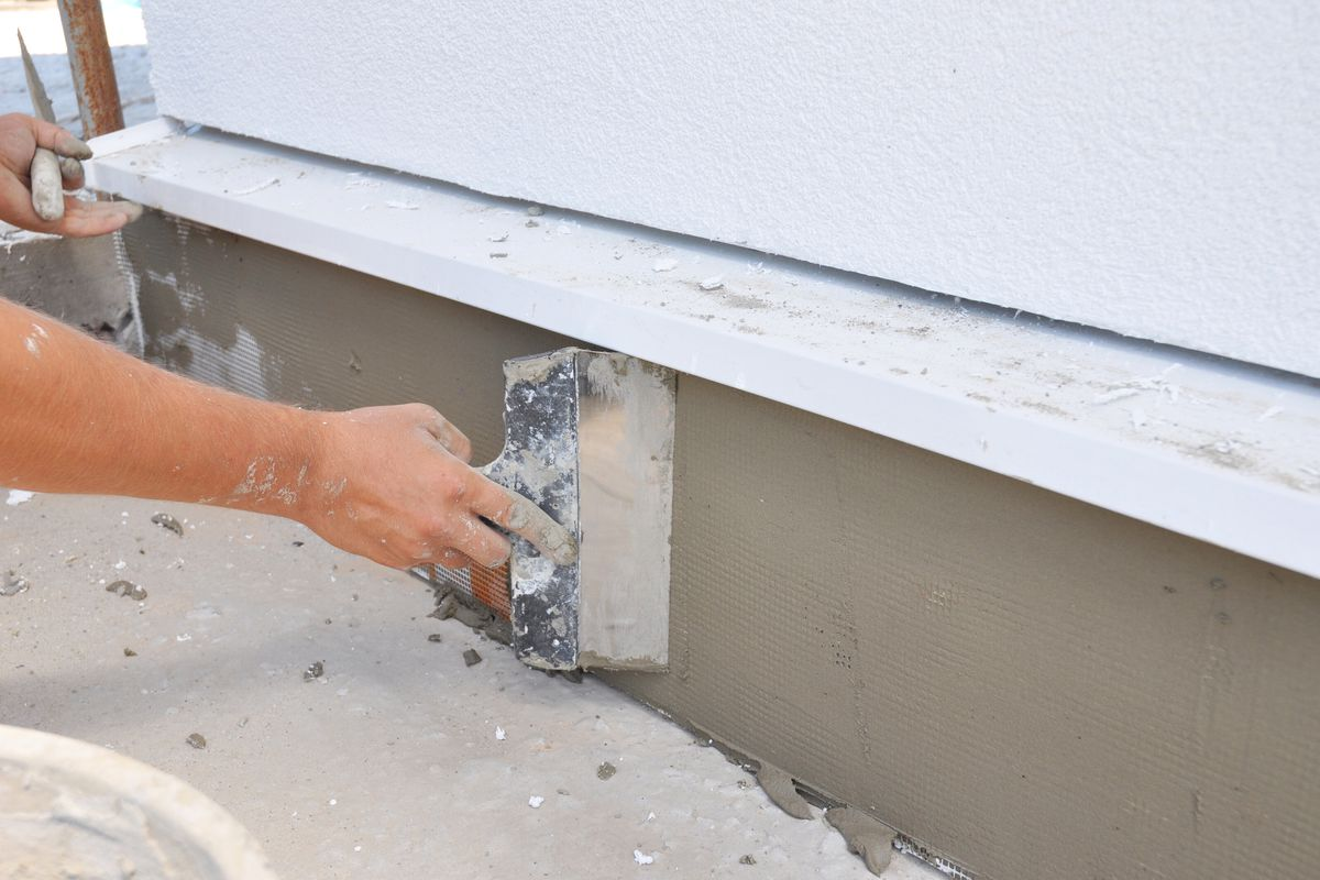 A foundation repair specialist repairs the foundation of a home.
