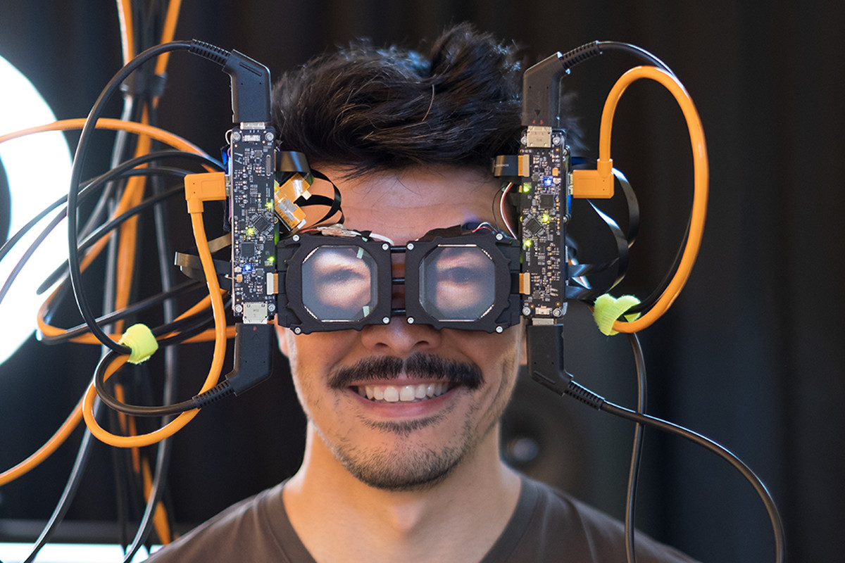 """Facebook's prototype for """"reverse passthrough VR,"""" a system for creating the illusion of eye contact while wearing a VR headset."""
