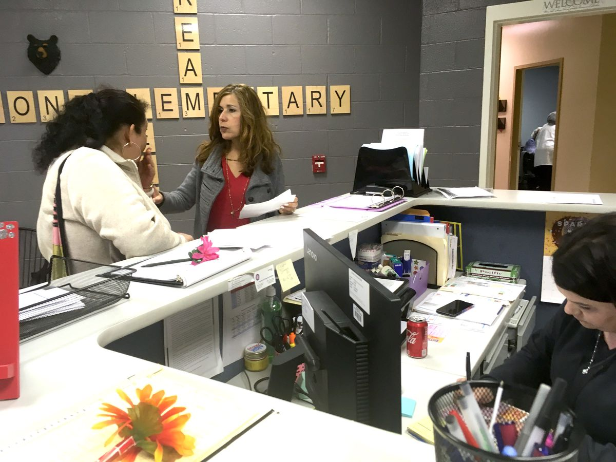 Lissette Bailey, center, is the bilingual mentor for Kate Bond Elementary School in Memphis.