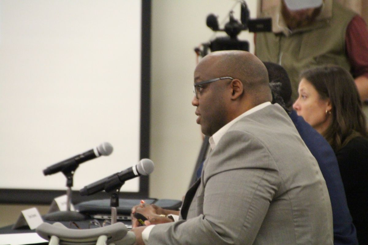 Ed Harper, a board member for Southwest, addressed district questions during the hearing.