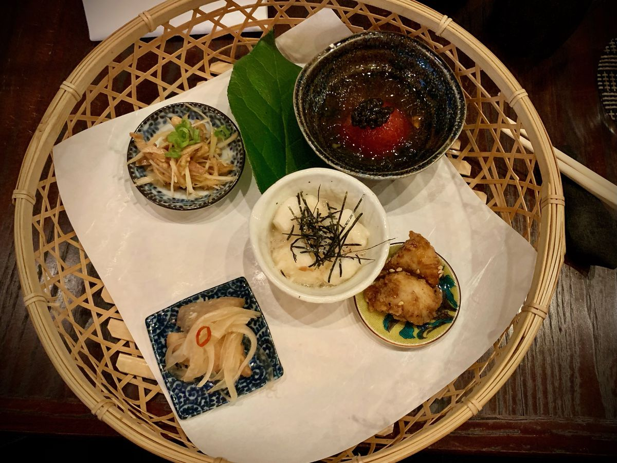 A basket with five omakase dishes