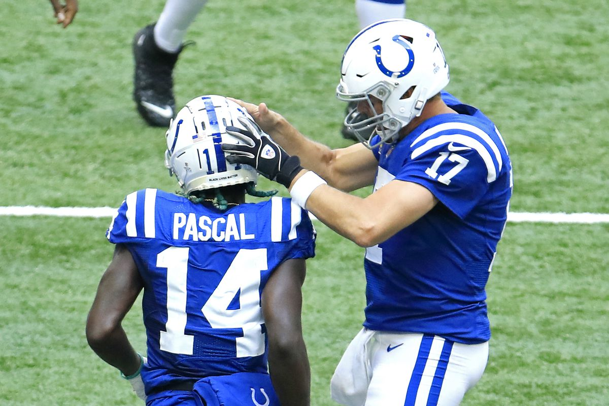 Zach Pascal #14 and Philip Rivers #17 of the Indianapolis Colts celebrate their touchdown against the Cincinnati Bengals during the first half at Lucas Oil Stadium on October 18, 2020 in Indianapolis, Indiana.