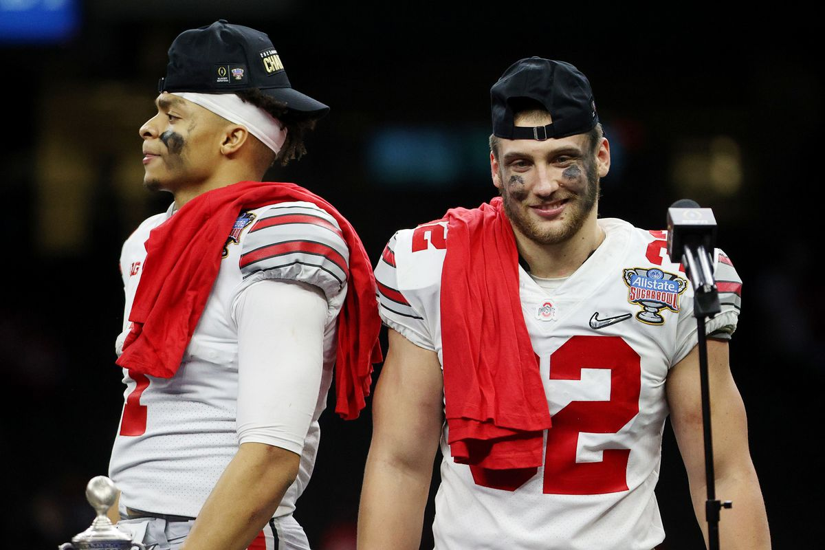 Justin Fields #1 and Tuf Borland #32 of the Ohio State Buckeyes react after the game against the Clemson Tigers during the College Football Playoff semifinal game at the Allstate Sugar Bowl at Mercedes-Benz Superdome on January 01, 2021 in New Orleans, Louisiana.