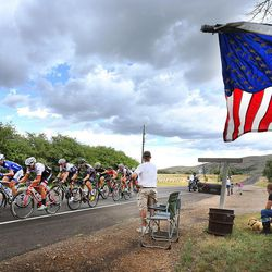 Orin Bishop and other members of his family watch as competitors pass his home near Woodland in stage seven of the Larry H. Miller Tour of Utah on Sunday, Aug. 7, 2016.