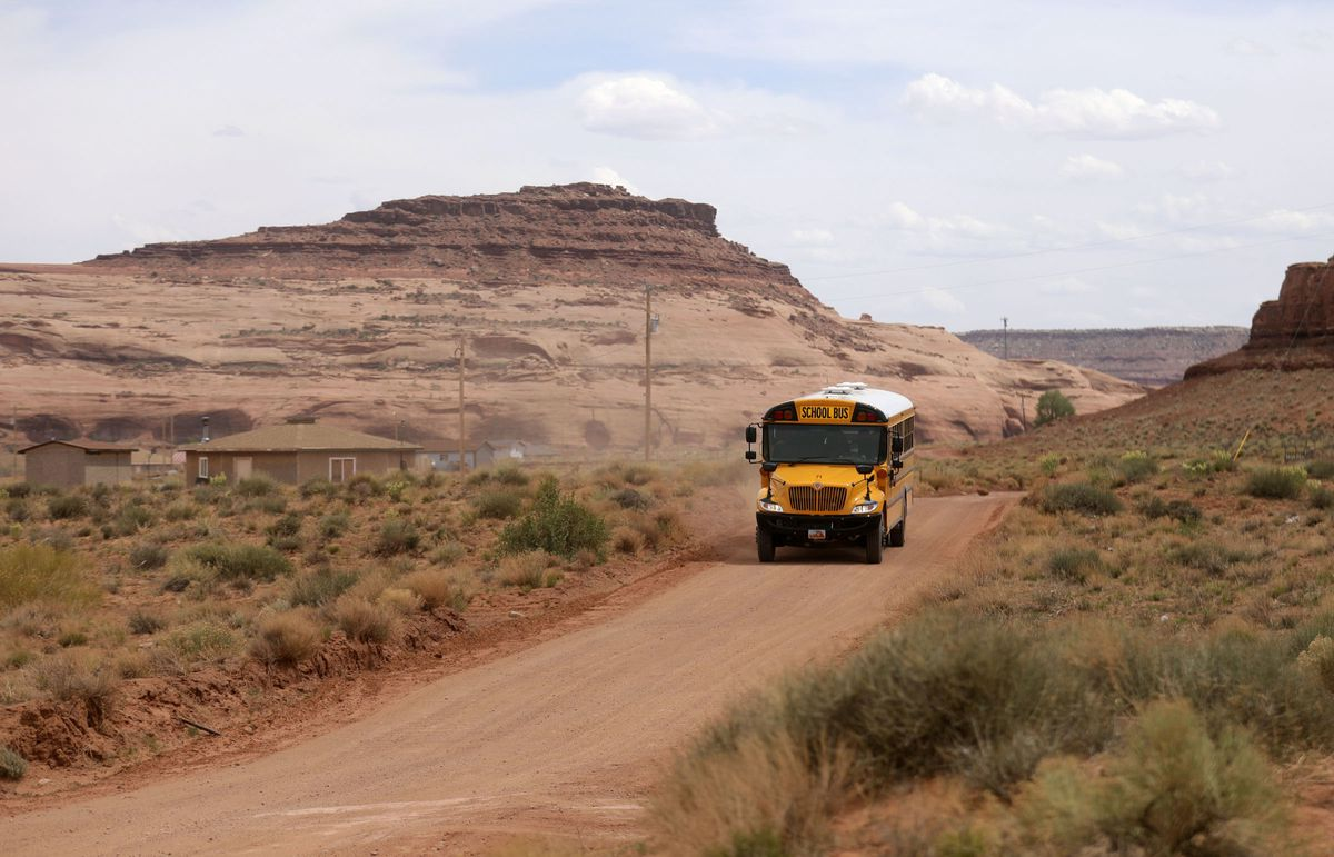 Rosie Fatt drives a school bus to deliver food and homework to students while schools are closed due to the COVID-10 pandemic in Oljato-Monument Valley, San Juan County, on Thursday, April 30, 2020. The Navajo Nation has one of the highest per capita COVID-19 infection rates in the country.