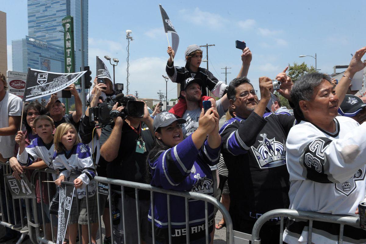 Jun 14, 2012; Los Angeles, CA, USA; Los Angeles Kings fans cheer at the Los Angeles Kings victory celebration parade on Figueroa Street. Mandatory Credit: Kirby Lee/Image of Sport-US PRESSWIRE