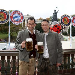 Sporting director Hasan Salihamidzic puts on a smile for the camera and draps his arm around the shoulders of a somber Niko Kovac at Oktoberfest, October 7, 2018.